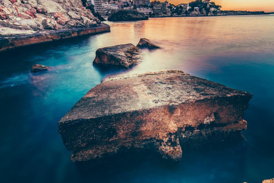 nature landscape water ocean sea beach rocks blue architecture building establishment sunset