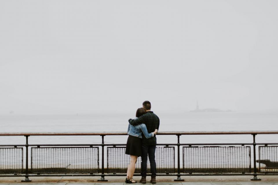 people man woman couple love water ocean sea lake barrier hug date sweet