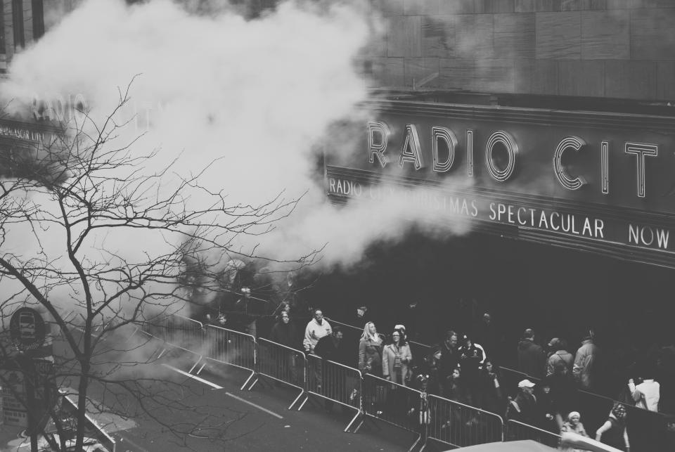 Radio City Music Hall music concert show people spectators city urban street black and white smoke fog