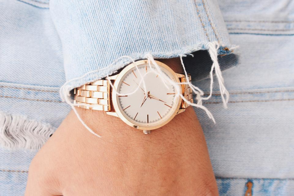 hand wrist gold watch time denim clothing
