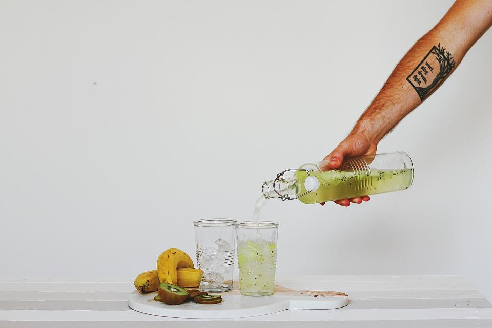 hand, glass, bottle, water, juice, banana, kiwi, fruit, food, health