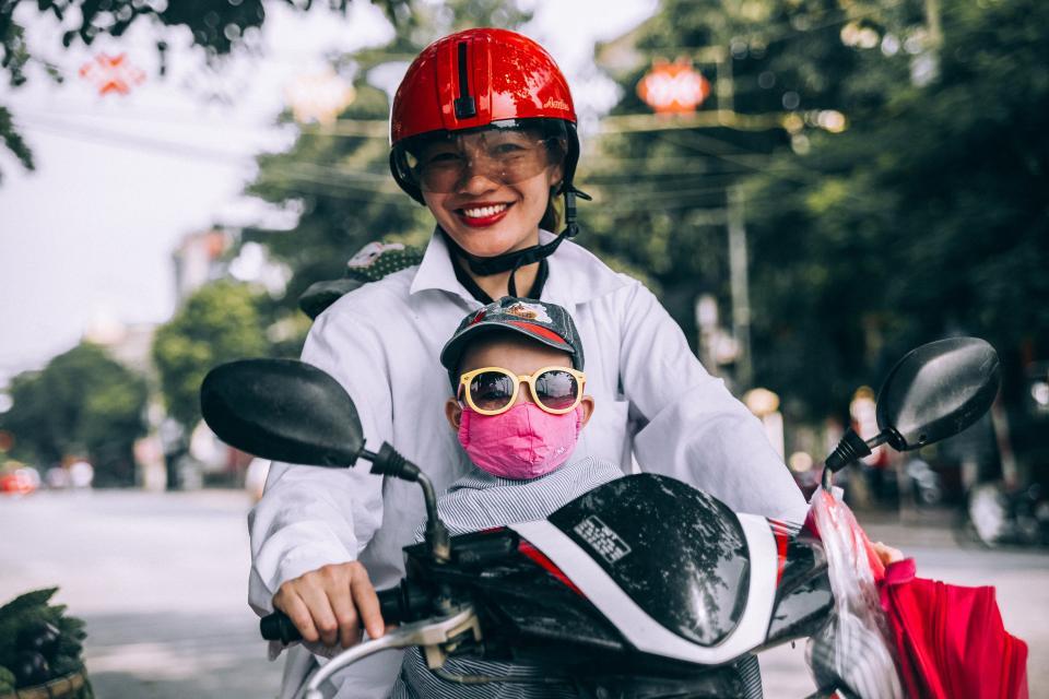 mother, son, riding, motorcycle, helmet, eyeglasses, road, street, trees, bokeh, kid, child, woman, boy, mask, smile, happy