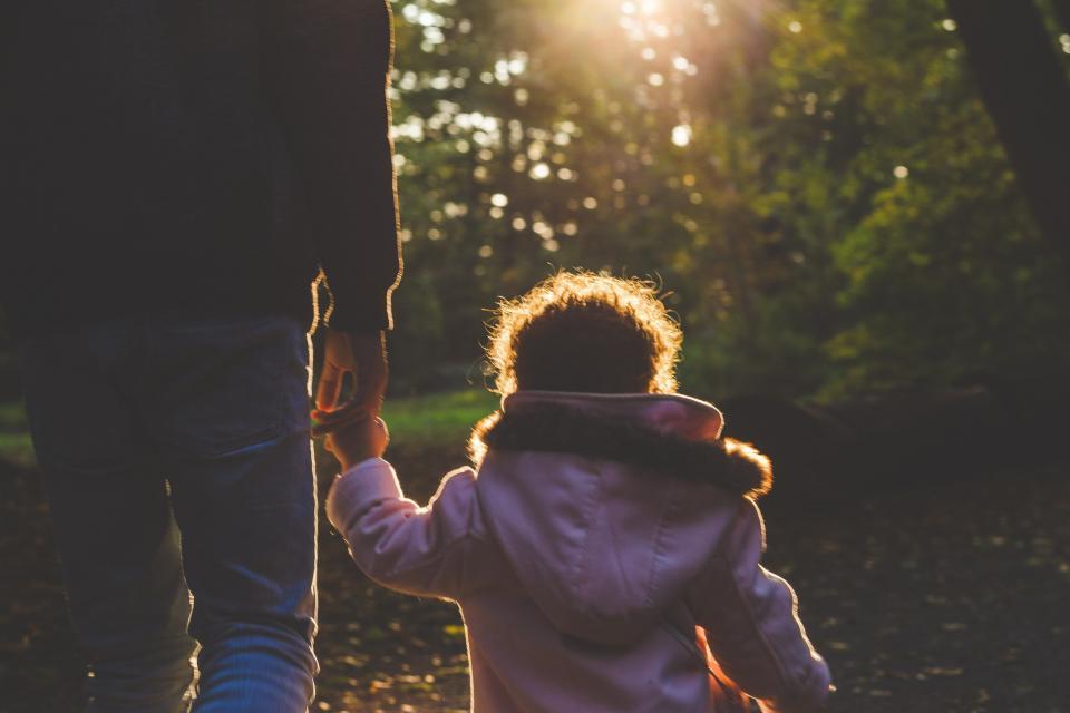 people man father baby kid child walking holding hands sunlight sunrise sunshine sunset trees plants nature bokeh