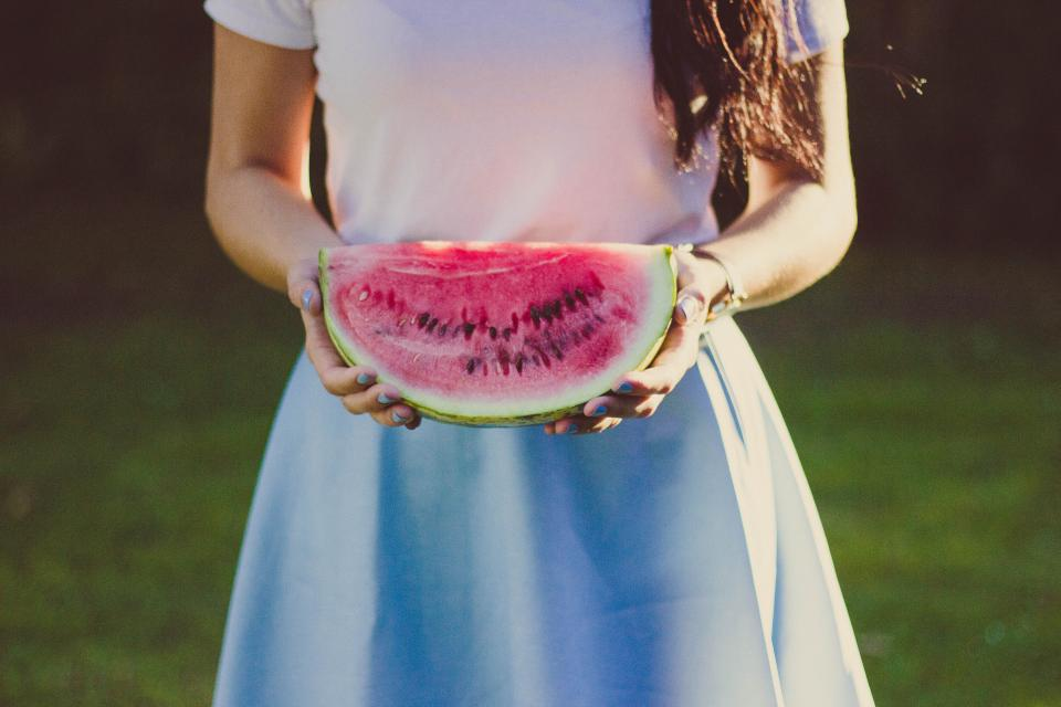 woman girl lady people body bust torso limbs hands hold watermelon sliced fashion style beauty