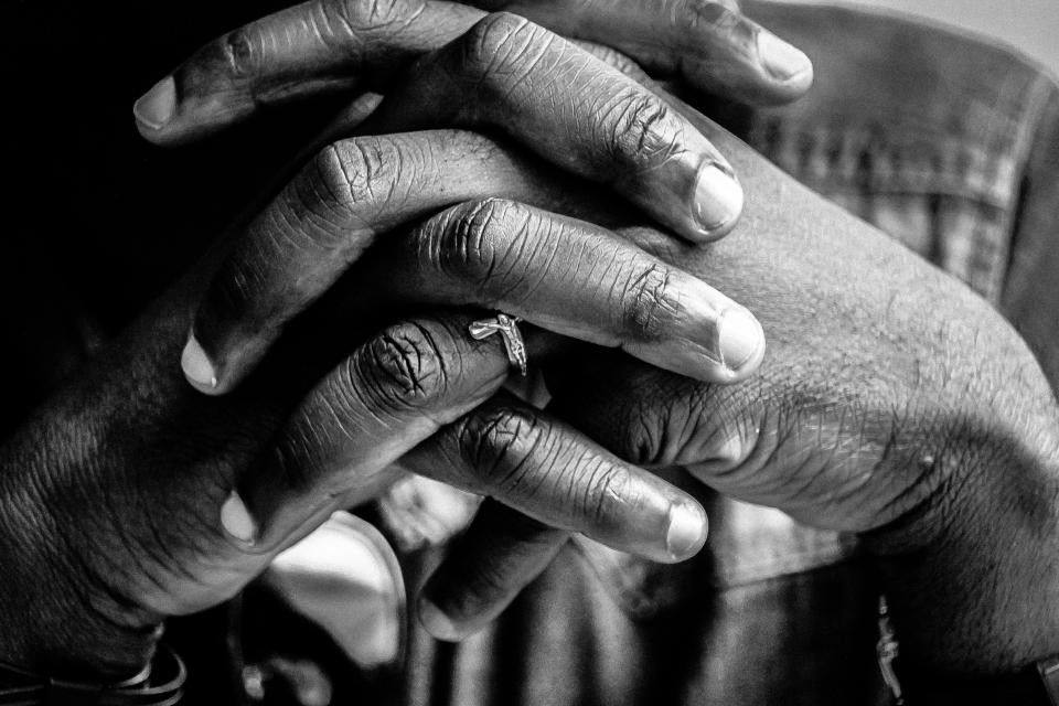 hands clasp pray person people ring still bokeh portrait black and white