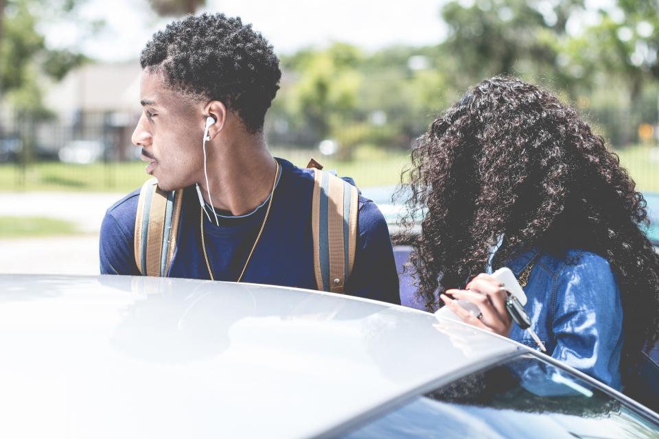man woman girl guy curly car vehicle bokeh trees couple key earphone backpack street necklace windshield