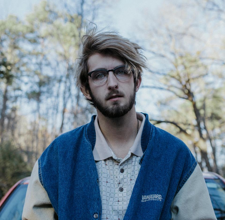 man, guy, male, fashion, model, eyeglasses, trees, sky, branches, clouds, nature, car, windshield, outdoor, beard, bokeh