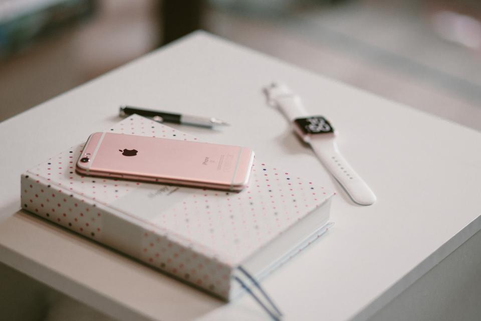 iphone apple mobile phone watch gadget technology notebook pen work desk blur