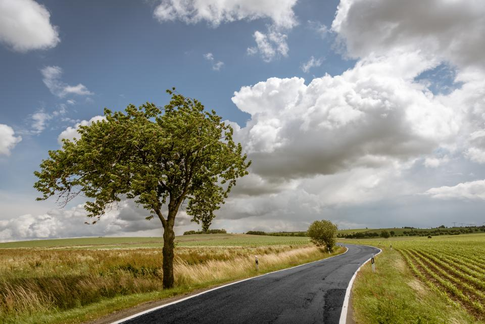road street adventure vacation trip green sky clouds blue white trees grass nature
