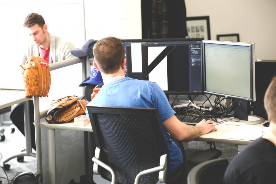 photoshop graphic design desktop computer monitors technology office desk working people team