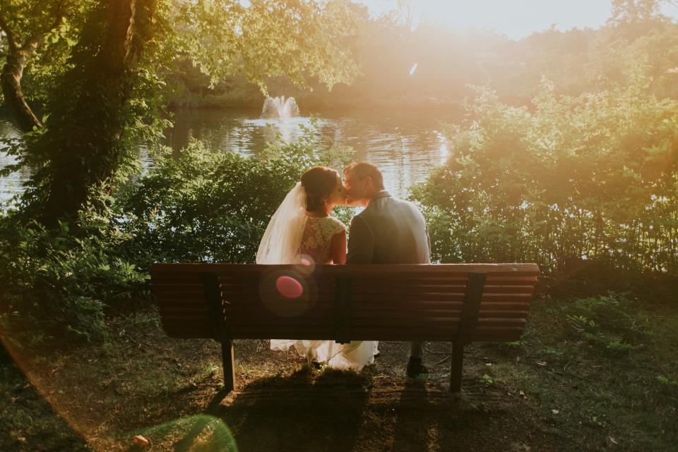 marriage wedding couple love man woman people kiss bench trees nature sunshine sunlight water river lake sweet gown suit wedding dress
