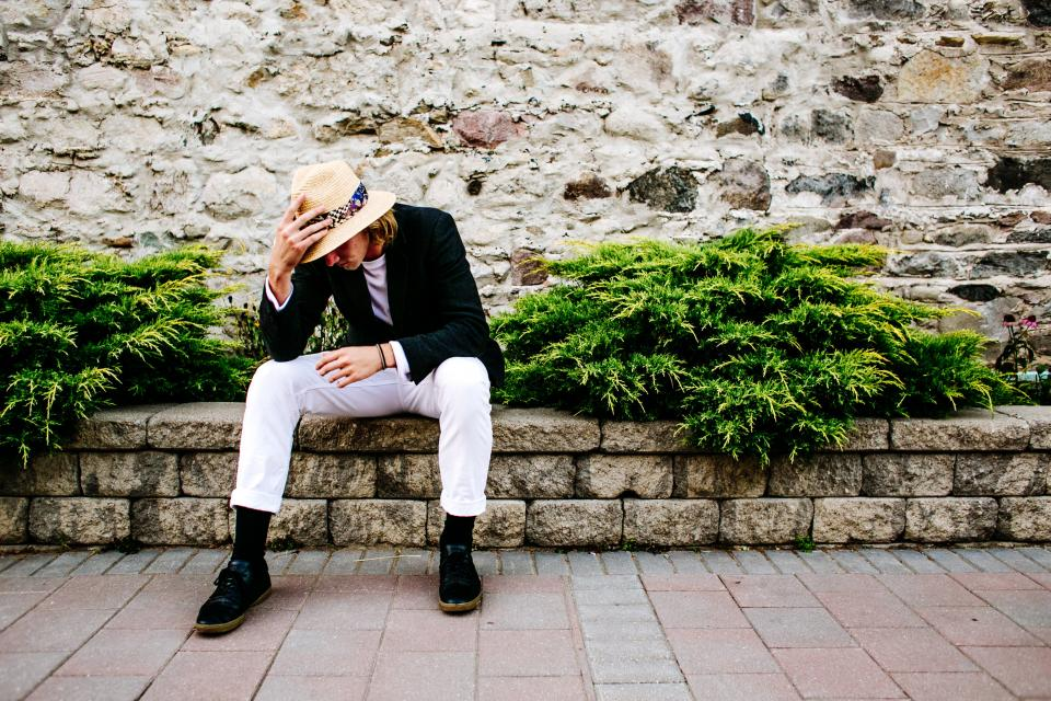green plants landscape wall rocks blocks people man guy clothing hat fashion model