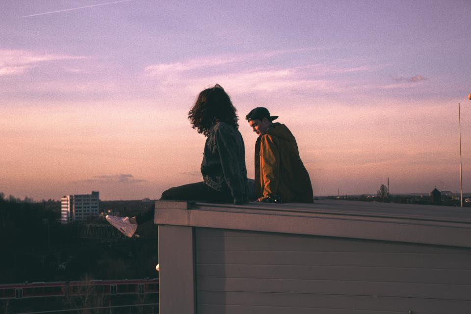 girl woman guy man people couple love romance rooftop purple sky sunset dusk talking
