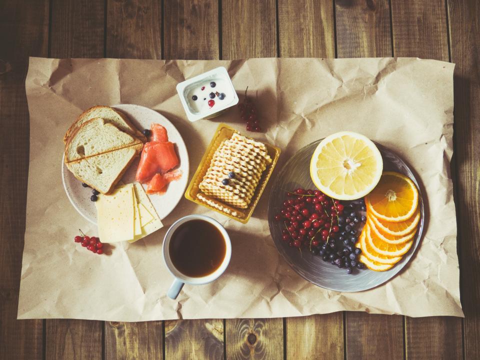 cookies, food, sweets, desserts, coffee, fruits, lemon, blueberries, cheese, bread, paper, table, cream, snack, breakfast