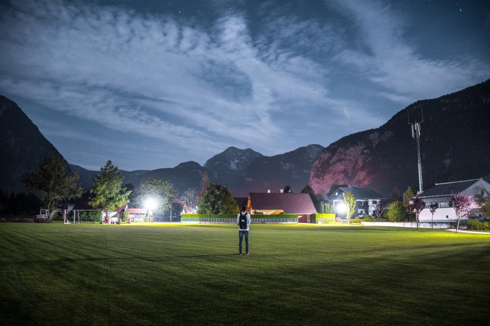 people, alone, man, playground, field, green, grass, house, trees, plants, dark, night, lights, sky, clouds, mountain, valley, landscape, nature