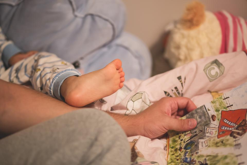 child, baby, infant, feet, legs, cute, adorable, bokeh, flesh male, father, people, story, book, time, read, bed, sheets