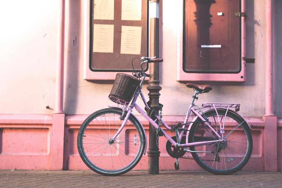 pink, wall, bike, bicycle, outside, window, sidewalk, pole, chain, lock, key