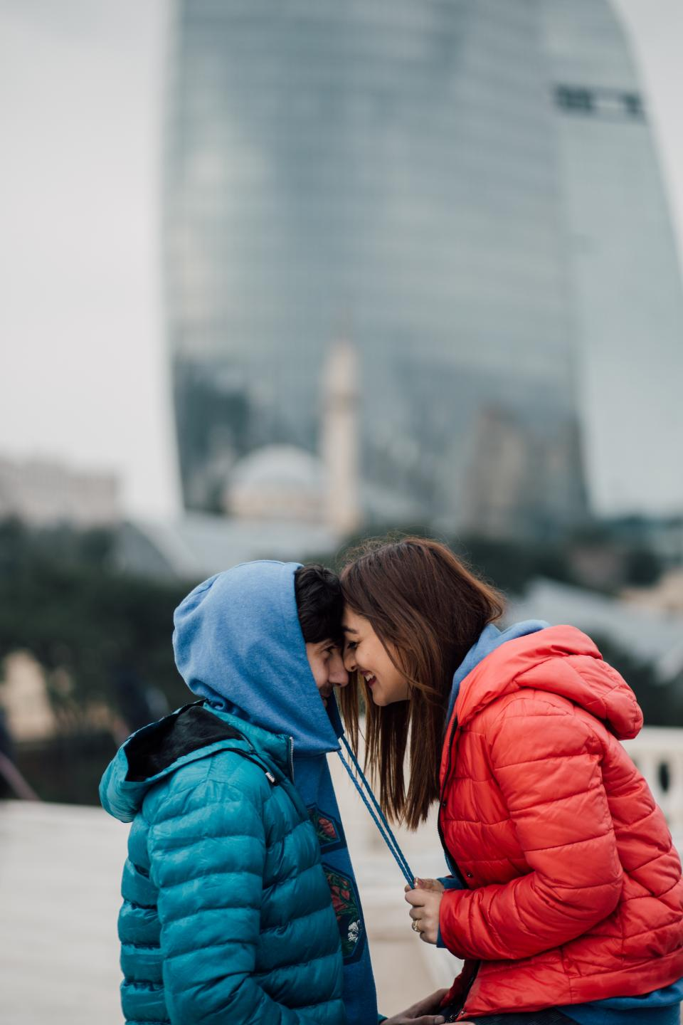 people man woman guy girl red blue hoodie jacket smile happy couple blur date