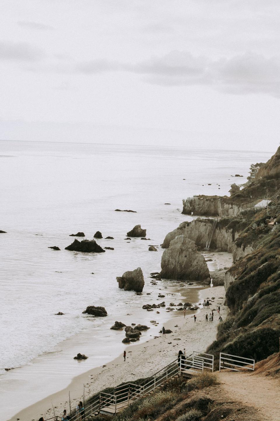 sea, ocean, water, waves, nature, beach, coast, sand, shore, people, crowd, family, friends, outdoor, summer, vacation, travel, grass, hill, highland, landscape, rocks, stairs, cliff