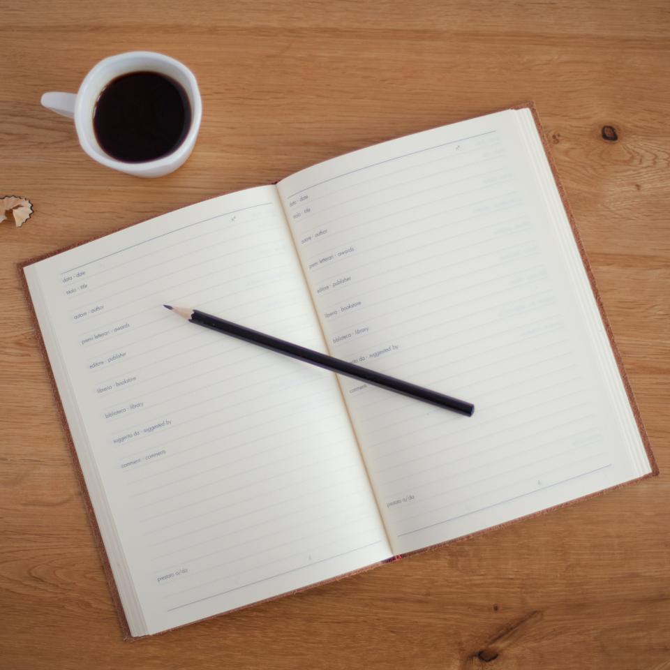 office work workspace business desk table journal notebook pencil shavings wood cup mug coffee still