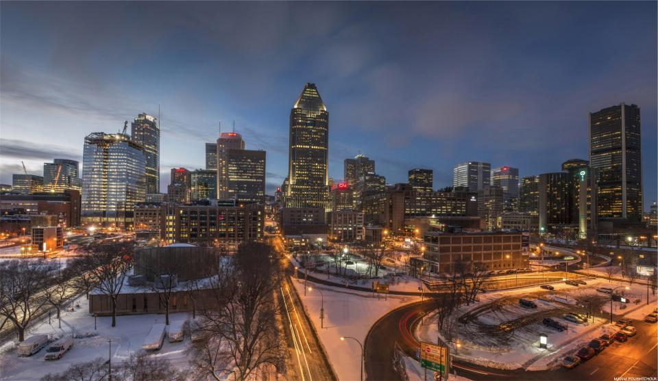 Montreal city night urban evening buildings towers architecture winter snow roads sky