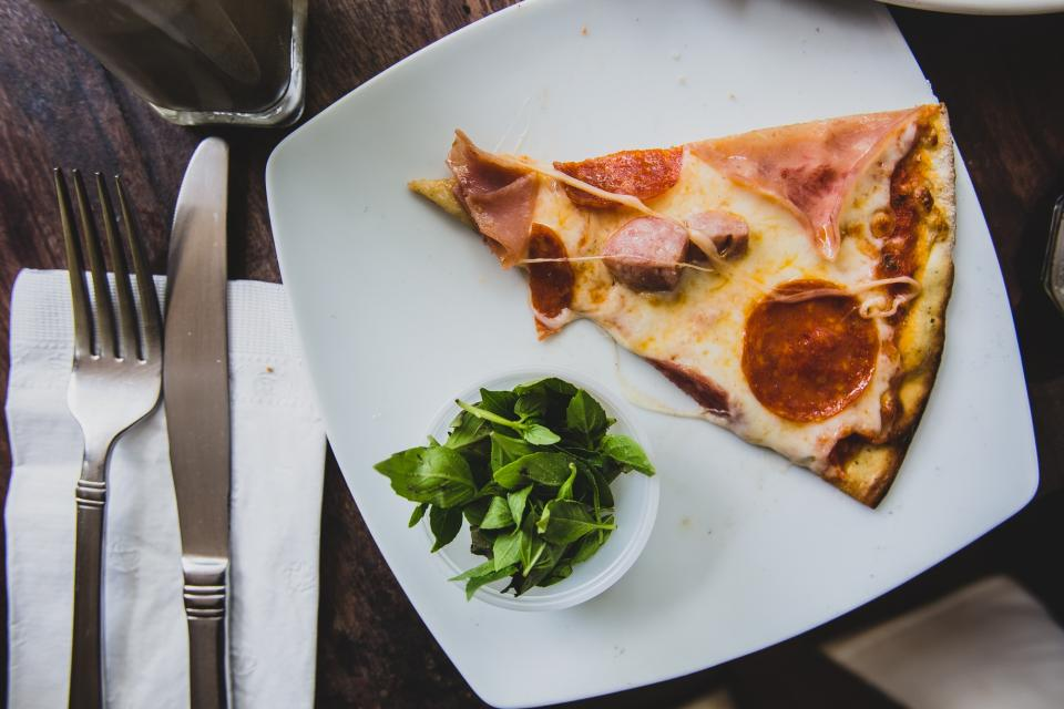 pizza food lunch dinner plate fork knife cutlery
