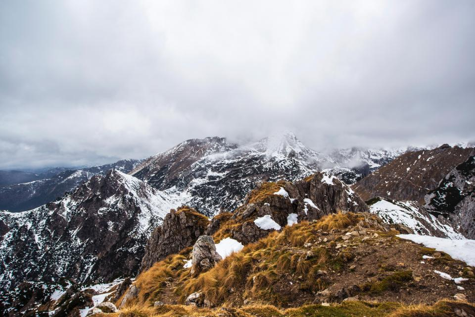 mountains peaks summit snow landscape nature outdoors sky clouds cloudy