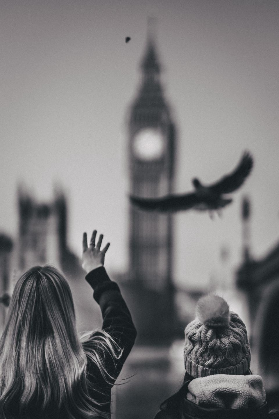people woman kid child mother parent black and white monochrome bird tower architecture clock time