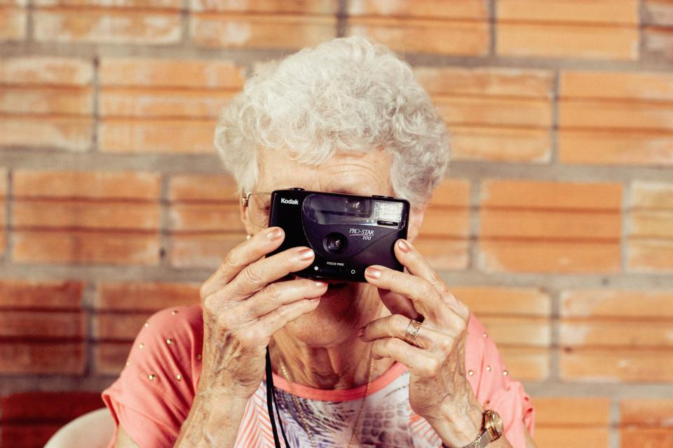 orange people woman camera photography photographer old grandma snap