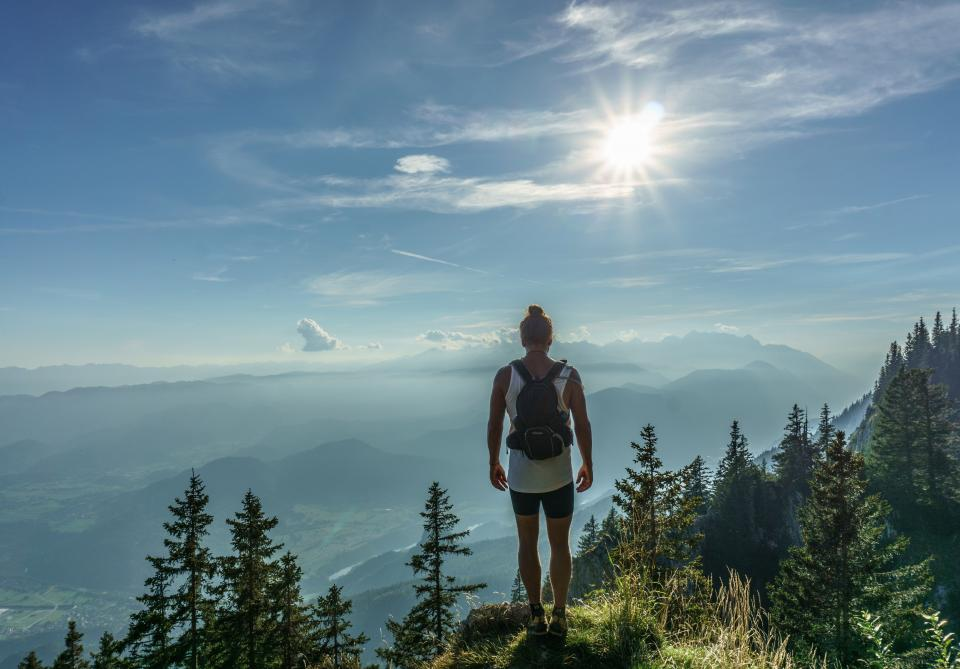 girl, woman, hiking, trekking, backpack, knapsack, mountains, hills, valleys, trees, forest, adventure, outdoors, nature, sunshine, blue, sky, summer, fitness, clouds, health