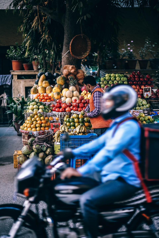 fruits, people, man, motorcycle, helmet, vendor, market, trees