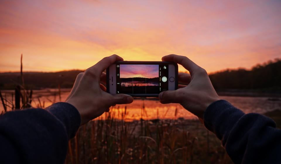 picture image shot photo cellphone mobile iphone camera sunset hands grass trees mountain hill