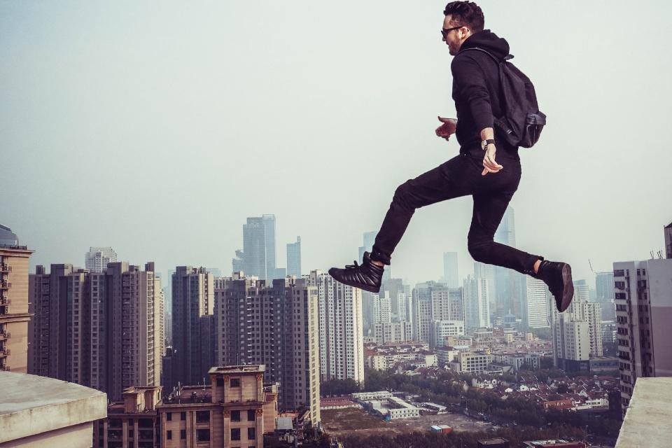 people, man, jumping, flying, sky, aerial, fog, building, roof, infrastructure, establishment, urban, city, adventurer, exhibition