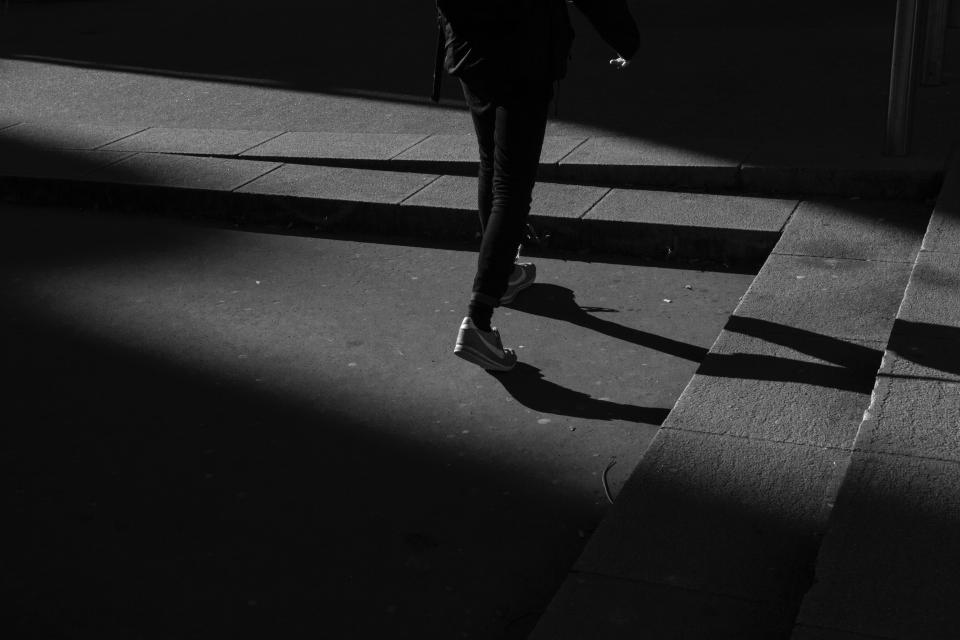 black and white dark night people walking light shadow
