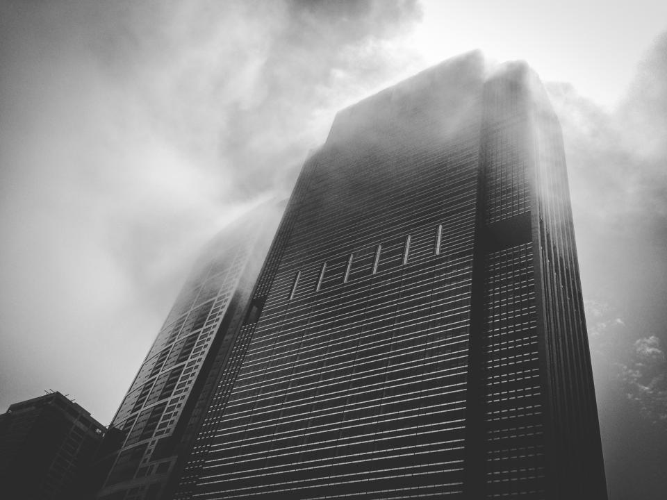 building high rise tower architecture fog clouds black and white city urban