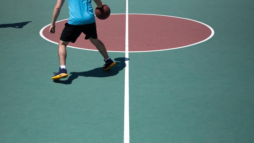 basketball, ball, spalding, court, sports, exercise, hobby, red, people, man, stance, shadow, nike, shoes, socks, game