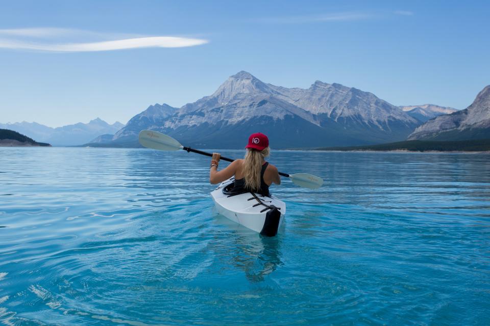 woman, girl, lady, people, back, snapback, cap, kayak, paddle, nature, landscape, mountains, peaks, summit, sea, ocean, water, ripples, sky, clouds, horizon, blue, fitness