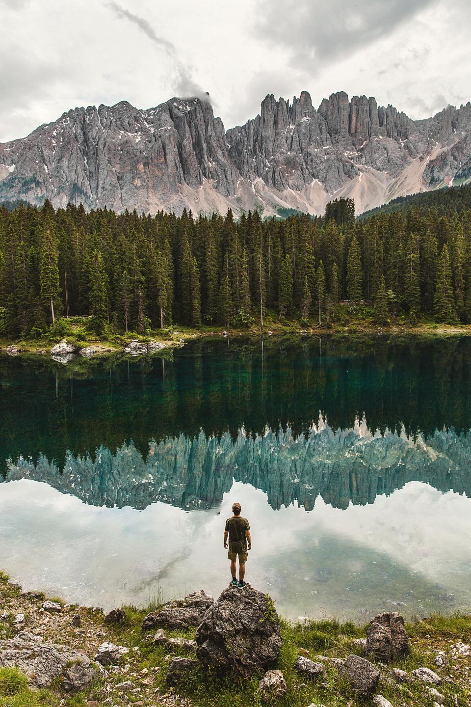 mountain, highland, cloud, sky, summit, ridge, landscape, nature, valley, hill, cliff, trees, plants, outdoor, lake, water, reflection, green, grass, people, man, guy, alone, millennials, travel, adventure