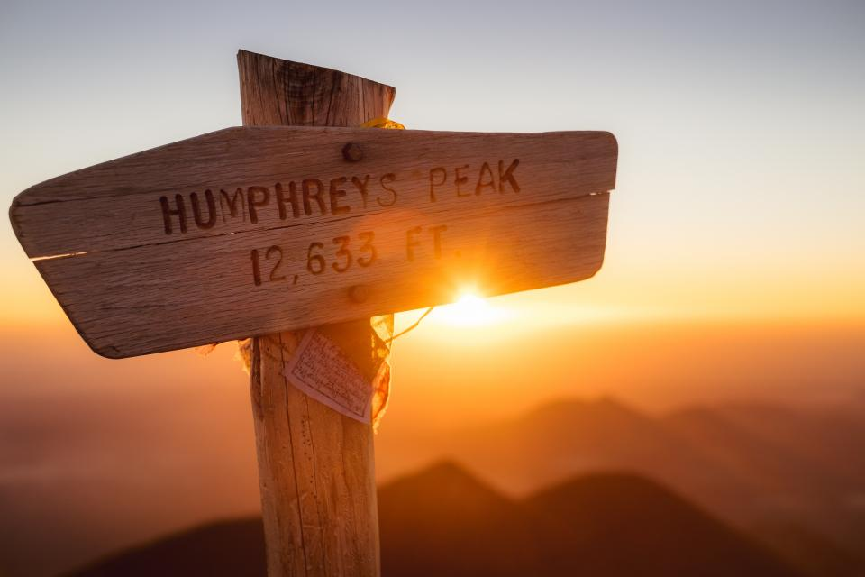 wood sign peak summit sunlight sunshine sunrise sunset ridge blue sky