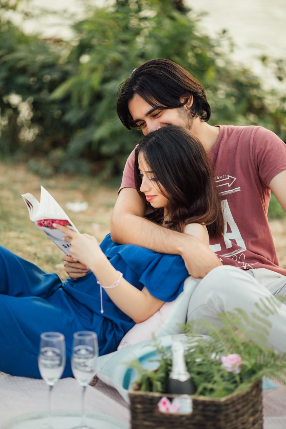 people, couple, guy, girl, picnic, date, love, hug, smile, happy, reading, magazine, outdoor, white, wine