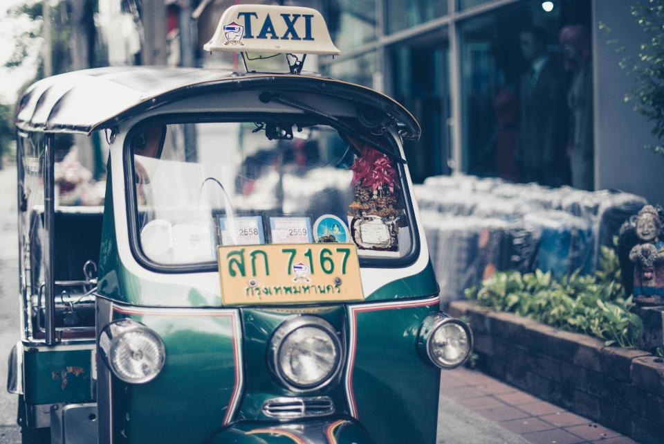 tricycle, lights, vehicle, asian, transportation, road, bricks, plants, statue, taxi, glass, bokeh, blur, shop, street