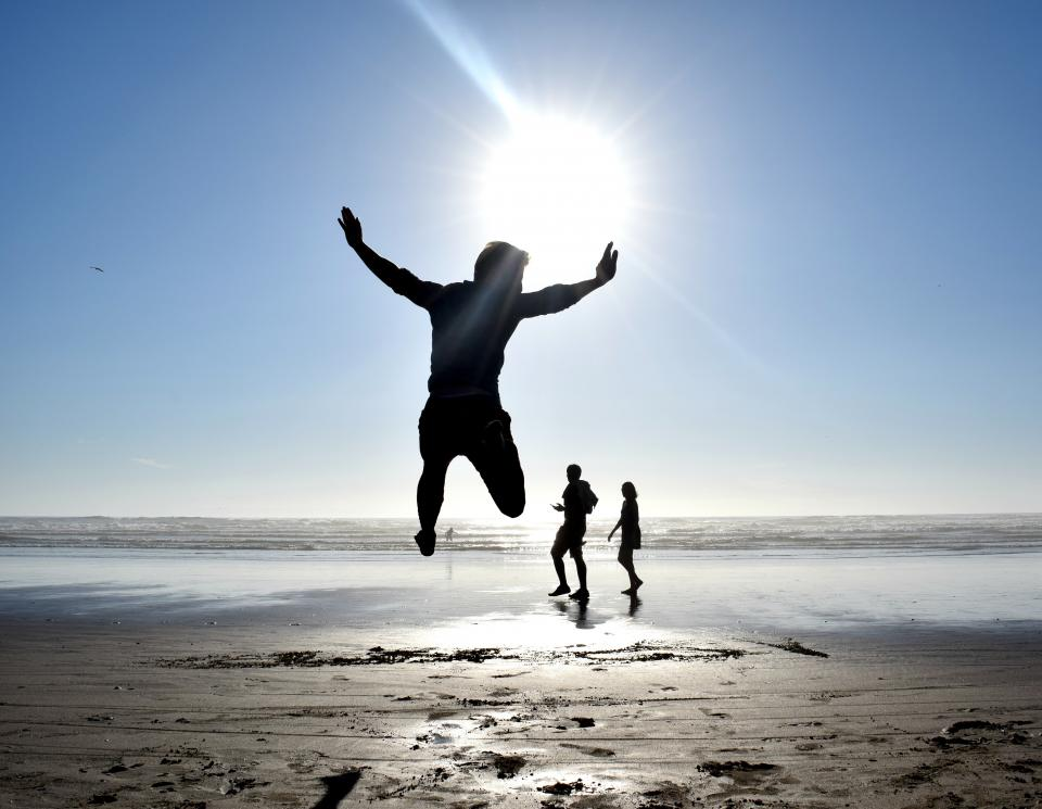 jump people man woman silhouette beach sand ocean sea sunlight sun