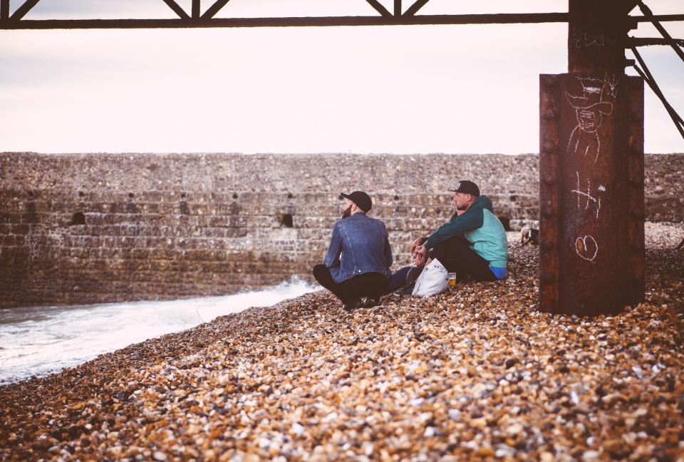 people, rest, stones, bridge, steel, building, wall, coast, picnic, sea, water