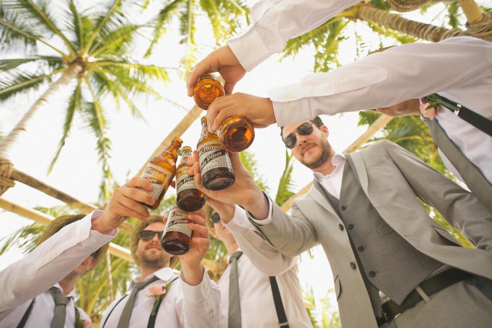 wedding groomsmen friends party celebration beer brews alcohol people group friends guys men suits palm trees sunshine sunglasses