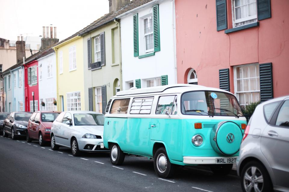 van car vehicle parking outside buildings establishments road lane street