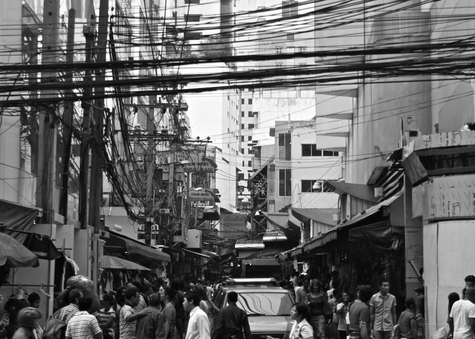 people crowd busy streets city pedestrians buildings architecture black and white