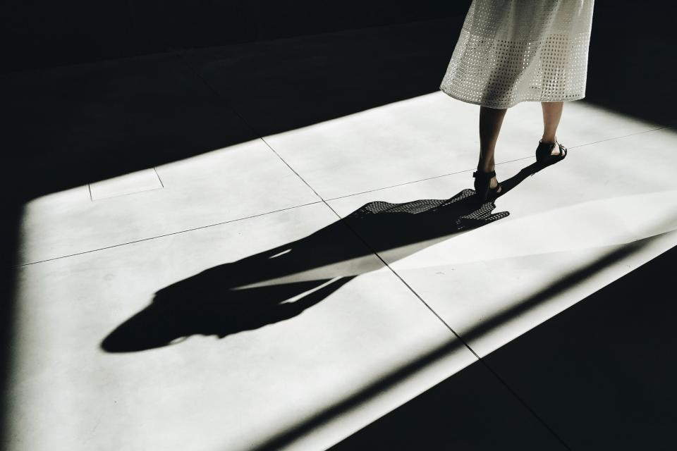 people woman shadow legs dark sunlight