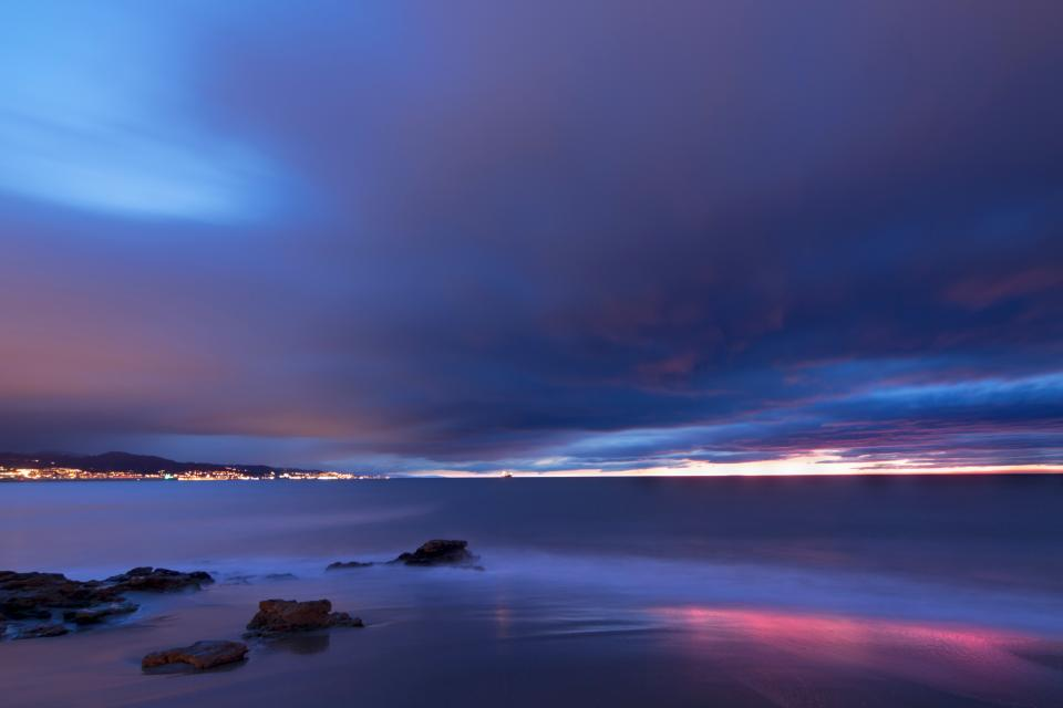 sea ocean water waves nature rocks horizon blue sky clouds sunset coast shore beach