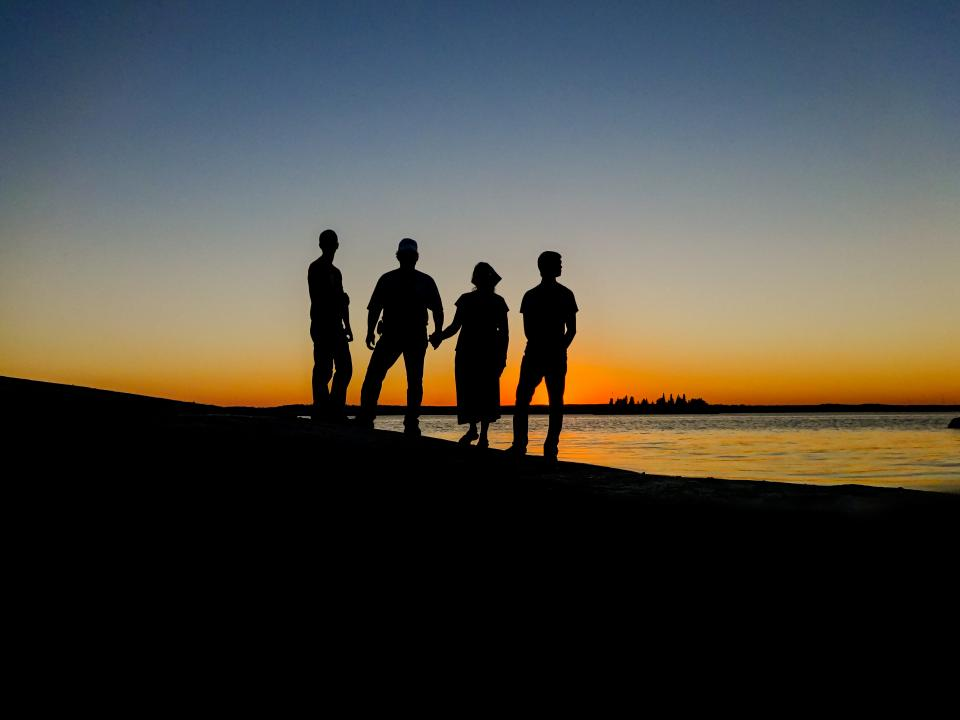 silhouette family island canada lake sunset people men woman dusk travel horizon evening reflection vacation group friends water