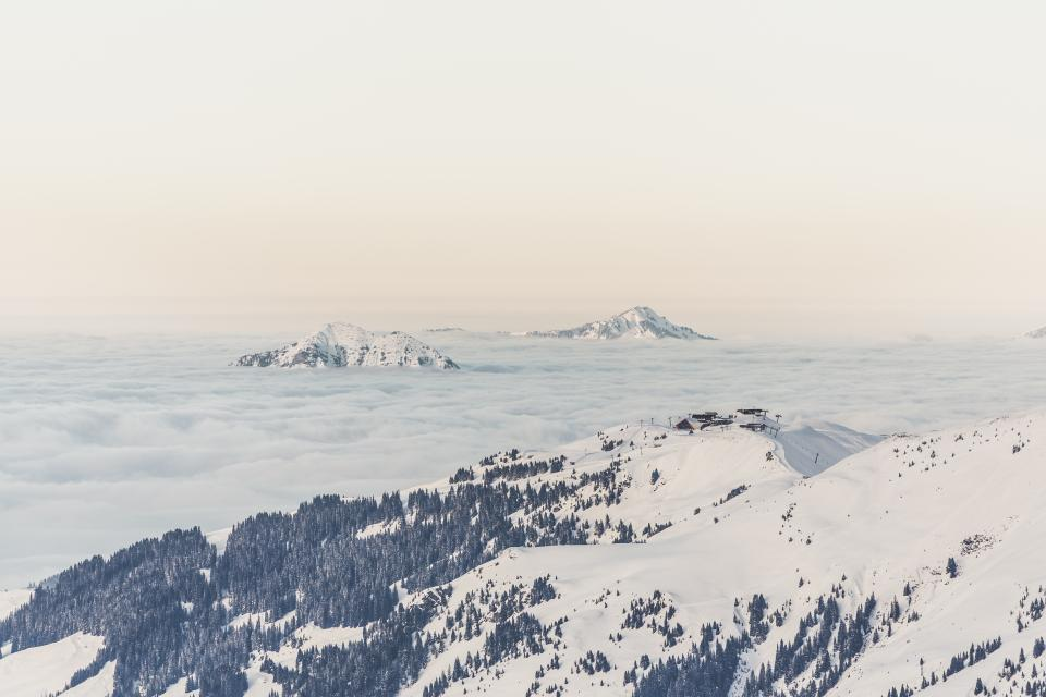 mountains hills cliffs peaks summit clouds sky outdoors adventure trees snow winter landscape nature